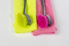Dishwashing brush green and red. Lime green and red dishwashing brushes with cloths in the same colours royalty free stock photos