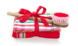A dishwashing brush on a red towel. And a colored striped kitchen cloth packed as a gift Stock Photography