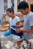 Dishwashing couple Stock Image