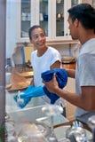 Dishwashing couple Stock Photos