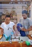 Dishwashing couple Stock Photo