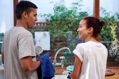 Dishwashing couple Stock Images