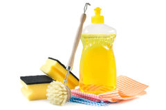 Dishwashing detergent. Bottle of yellow dishwashing detergent with cleaning equipment including sponges, cleaning cloths and brush Stock Image