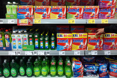 Dishwashing detergent. GERMANY - MAY 2017: Plastic bottles of dishwashing liquid and dishwasher tablets in a REWE supermarket Stock Photo