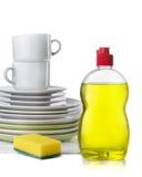 Dishwashing liquid. Bottle of dishwashing liquid and stack of utensils isolated on white royalty free stock images