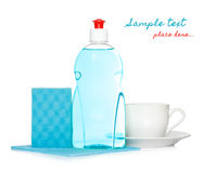 Dishwashing liquid and clean cup Royalty Free Stock Images