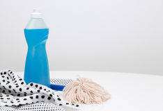 Dishwashing liquid, dishtowels and brush Stock Photos