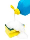Dishwashing liquid and sponge Royalty Free Stock Image