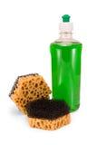 Dishwashing liquid and sponge Royalty Free Stock Photography