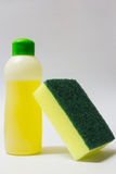 Dishwashing liquid and sponge Stock Images