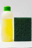 Dishwashing liquid and sponge Royalty Free Stock Image