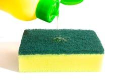 Dishwashing liquid and sponge Royalty Free Stock Photo