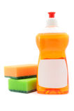 Dishwashing Liquid And Sponges. A bottle of dish-washing liquid with a blank label and sponges isolated on a white background royalty free stock image
