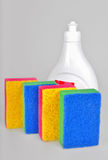 Dishwashing liquid and sponges Royalty Free Stock Images