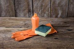 Dishwashing liquid, sponges, rubber Gloves Royalty Free Stock Photography