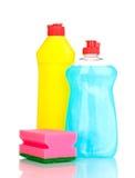 Dishwashing liquids and sponge. Over the white royalty free stock image