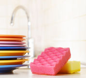 Several plates and a kitchen sponge Royalty Free Stock Photography
