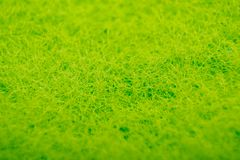 Dishwashing sponge in macro view. Texture royalty free stock photography