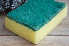 Dishwashing sponge. On wooden background Royalty Free Stock Images