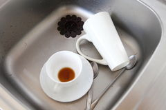 Dishwashing. White dishes in the kitchen sink. Stock Image