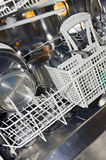 Dishwashwer sul lavoro Fotografie Stock