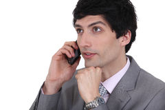 Dishy businessman on phone. With dreamy eyes Royalty Free Stock Image