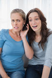 Disillusioned friends listening to mobile phone Stock Image