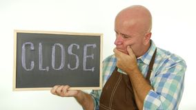 Disillusioned Man With Close Word Written on Chalkboard Gesturing Disappointed.  stock footage