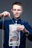 Disincorporate del hombre de negocios un billete de banco como tela de punto Imágenes de archivo libres de regalías