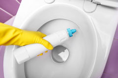Disinfect the toilet. Process toilet disinfectant. Close-up. Hand holds a bottle stock photos
