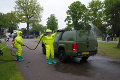 Disinfecting a military vehicle Royalty Free Stock Photo