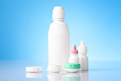 Disinfecting solution for contact lenses and eye drops on blue background Stock Image