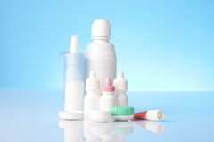 Disinfecting solution for contact lenses and eye drops on blue background Stock Photography