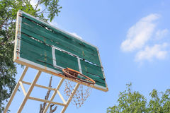 Disintegrated basketball hoop. Basketball court disintegrated in rural areas Stock Images