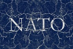 Disintegration, decline and breakdown of NATO. Defense and military alliance is in bad and poor condition - decomposition, degradation and cracks Stock Photo
