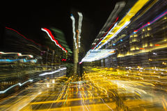 Disintegration of the light. Burst of the city lights in the night Stock Photography