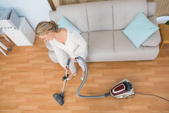 Disinterest woman cleaning her living room Stock Photos