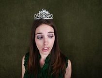 Disinterested Homecoming Queen. Young Disinterested Homecoming Queen on green background Stock Photos