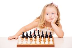 Disinterested little girl and chess Stock Photo