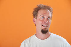 Disinterested Man. Disinterested Caucasian man with goatee on an orange background Stock Photo