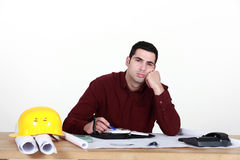 Disinterested worker in office Royalty Free Stock Photos