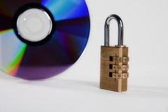 Disk. The disk protected by a code on a white background Royalty Free Stock Photography