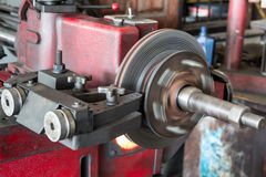 Disk brake machine working to rebuild serface Stock Image
