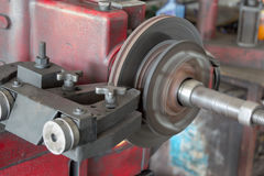Disk brake machine working to rebuild surface Stock Photos