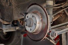 Disk brakes at car. Closeup photo of car disc brakes servicing Stock Photography