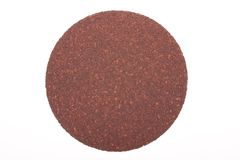 Disk of brown sandpaper. On white background Stock Images