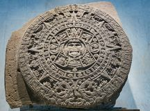 Disk calendar of ancient Maya Indians stock images