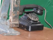 Disk dialer of old vintage black phone close-up.  royalty free stock images