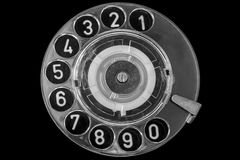 Disk dialer. A rotary dial is a component of a telephone or a telephone switchboard that implements a signaling technology in telecommunications known as pulse stock image