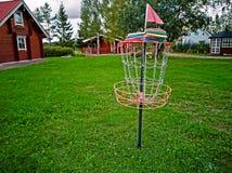 Disk in a disk golf basket stock image